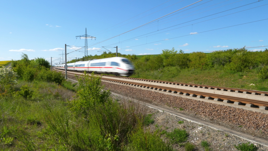 Dauborn, Germany - May 15, 2019: Tracking shot of a passing ICE train on the high speed line Frankfurt - Cologne near Limburg. ICE is a high speed train system in Germany