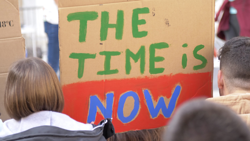 The Time is Now poster in a Meeting due Clime Change. Activists in action against the Global Warming Royalty-Free Stock Footage #1029607739