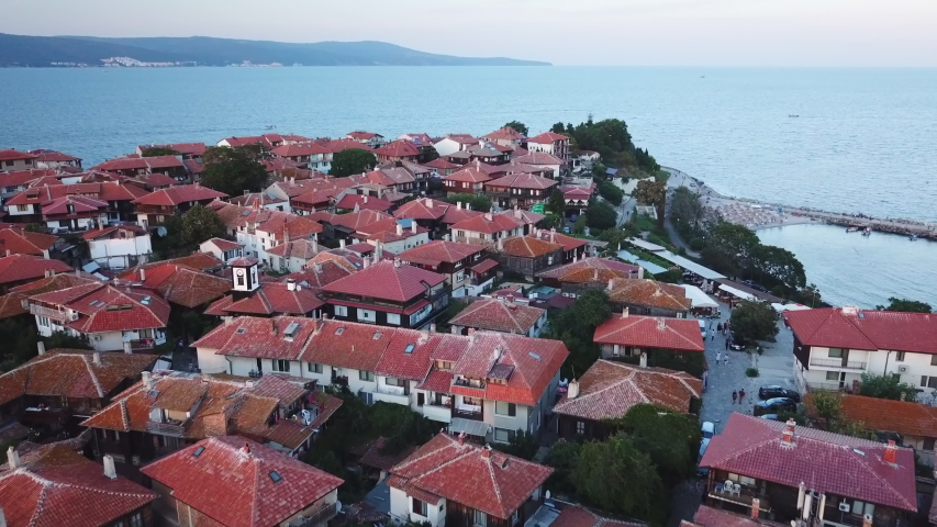Aerial view of roofs old Nessebar, ancient city on the Black Sea coast of Bulgaria, UNESCO World Heritage, on sunset