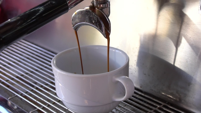 Cup Of Coffee Being Poured From A Professional Espresso Machine. | Shutterstock HD Video #1029623603