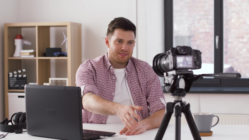 Blogging, videoblog and people concept - male blogger with camera recording video at home | Shutterstock HD Video #1029629033