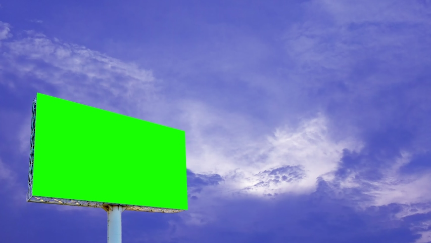 Large green billboards on a blue sky and white clouds, time laps | Shutterstock HD Video #1029638012