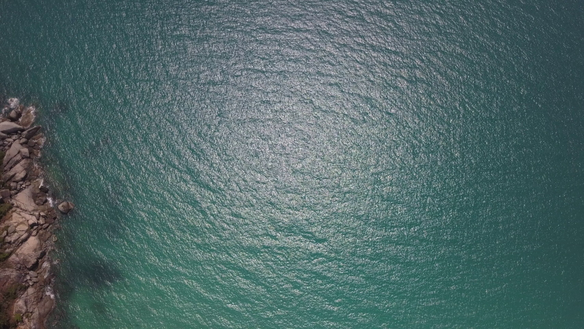 Top down view never ending aerial footage of sea waves against the rocky line | Shutterstock HD Video #1029639932