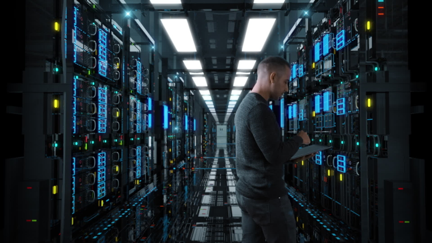 System Administrator Man With A tablet Standing In A Futuristic High Tech Server Room. Camera move forward. IT Technician 3d render concept. Crypto Currency Mining. Bitcoin farm. Prores 10 Bit mov.
