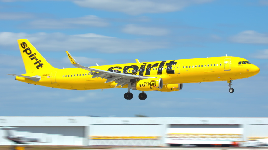 FT. LAUDERDALE, FL - 2019: Spirit Airlines Yellow Airbus A321 Commercial Passenger Jet Airliner Landing at Fort Lauderdale Hollywood FLL International Airport Arriving on a Sunny Day in South Florida