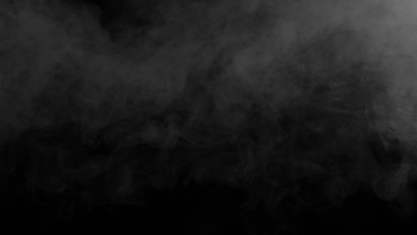 Smoke Jet Slowly Disappears. Gray smoke on a black background slowly dissipates and disappears from the screen   Shutterstock HD Video #1029748847