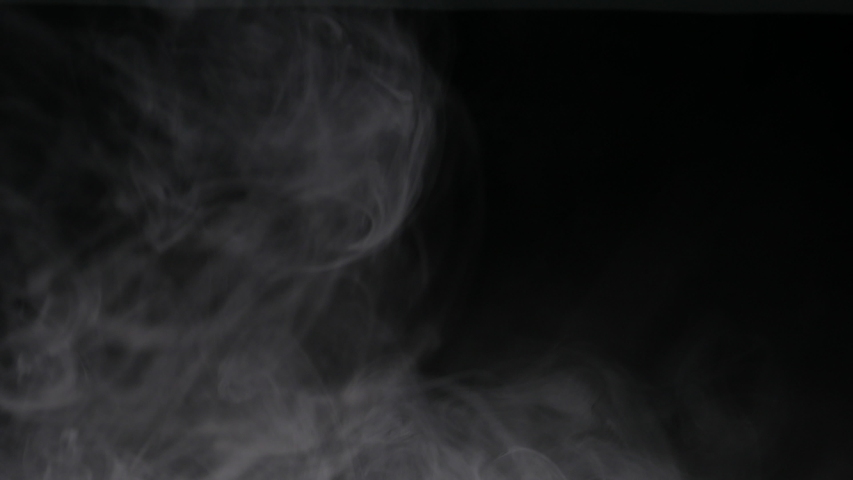 Clouds of wispy smoke / vapor on black background for compositing. Enters frame from top and falls / dissipates | Shutterstock HD Video #1029789083
