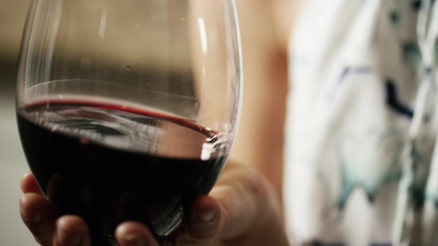 Red wine in glass getting swirled | Shutterstock HD Video #1029813620