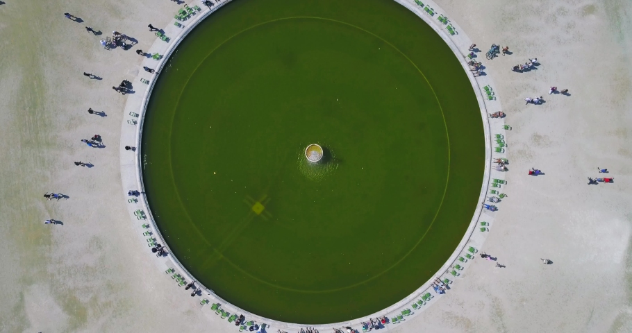 Aerial shot beautiful top view of the fountain in the middle of the seated bright green grass, near Louvre, Paris | Shutterstock HD Video #1029815960