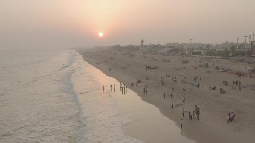 Sunset at the ocean beach, Puri, Orissa, India, 4k aerial ungraded