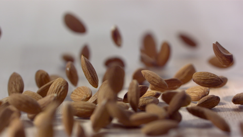 Almonds Fall And Roll On Flat Wooden Surface | Shutterstock HD Video #1029837119