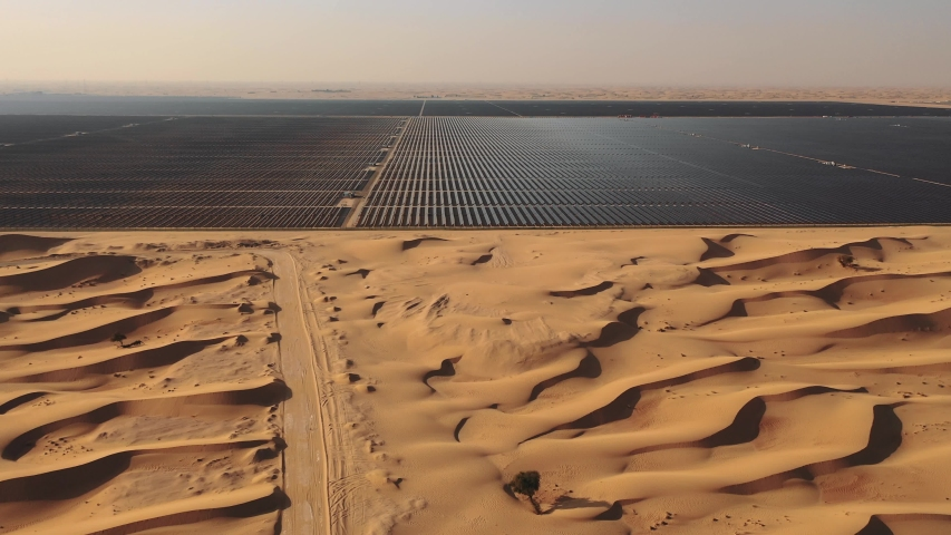 AERIAL. Top view of huge solar energy plant in the desert. Royalty-Free Stock Footage #1029841088