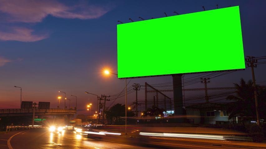 Advertising billboard green screen on sidelines of expressway with traffic at evening, time lapse. | Shutterstock HD Video #1029857579