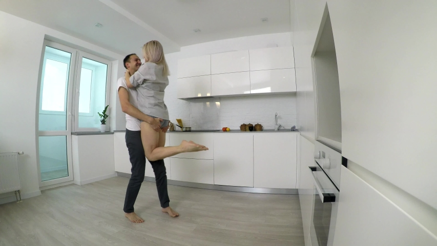 Happy young couple dancing in kitchen #1029858578