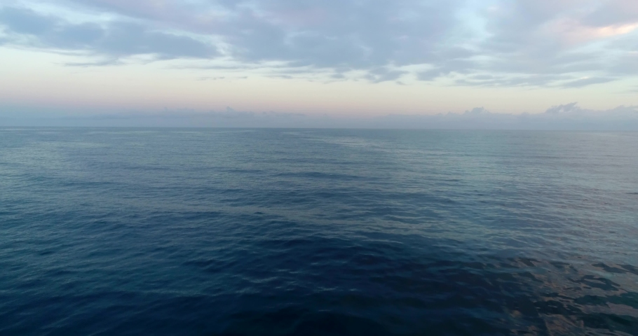4k aerial drone shot flying over the ocean at sunrise. Very calm and peaceful feeling. | Shutterstock HD Video #1029864185
