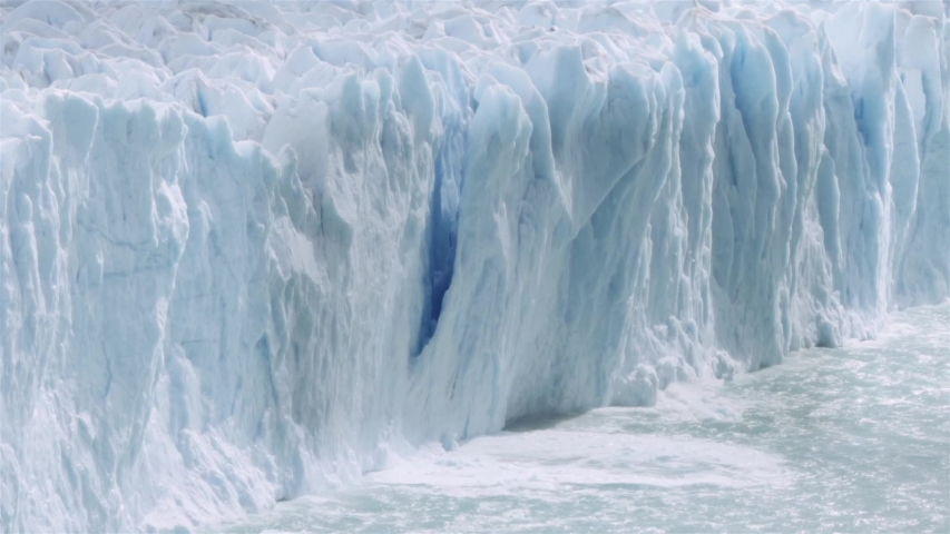 Chunk of glacier collapsing into the lake Argentino on the patagonian region. Slow motion.  Royalty-Free Stock Footage #1029864755