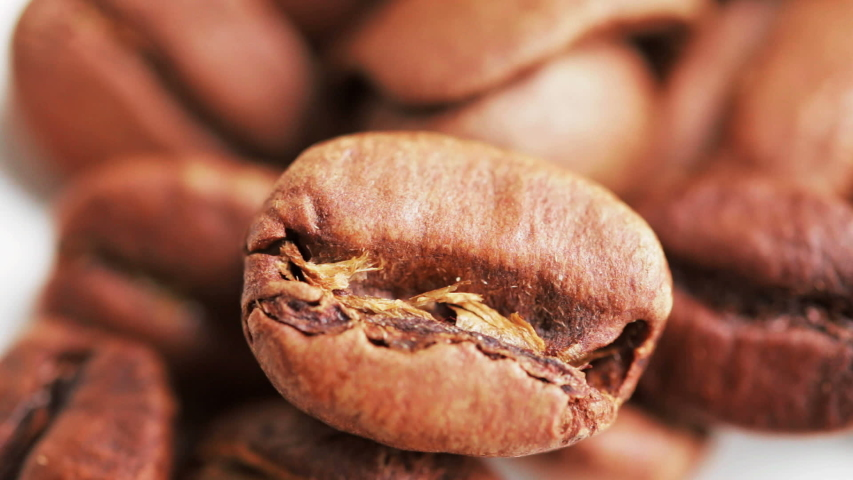 Macro shot of coffee beans. Selective focus. Medium roast. Camera locked down. | Shutterstock HD Video #1029865634