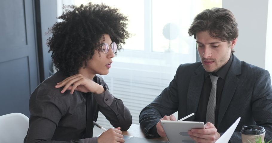 Business colleagues doing paperwork and using digital tablet | Shutterstock HD Video #1029868463