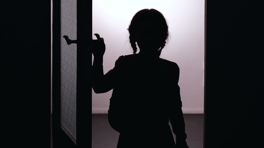 Kids silhouette entering house, dangerous to walk alone at night, child safety