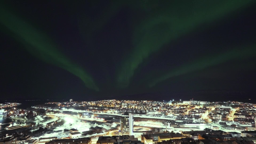 Timelapse over the city with the norhternlight passing over it. Narvik City in norhtern Norway.