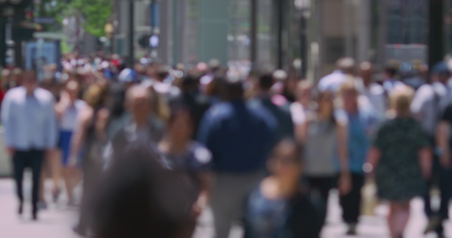 Crowd of people walking busy street in New York City shot out of focus #1029888647