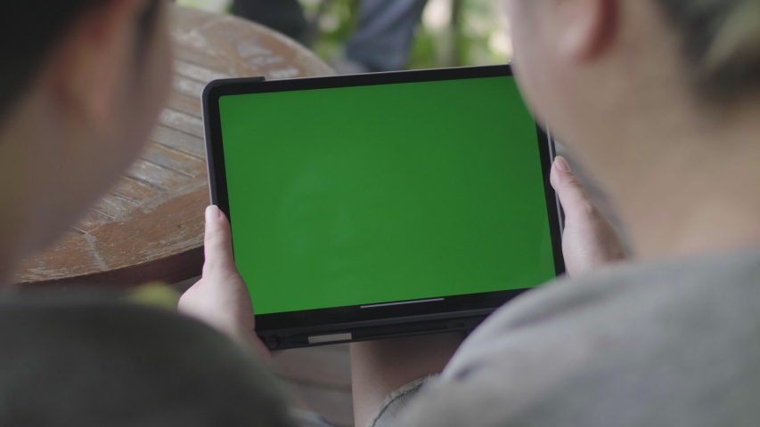 Mother and Son using digital tablet together, Green screen chroma key. | Shutterstock HD Video #1029915530
