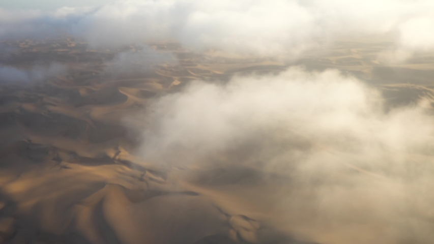Wide Epic shot of Namibian Sossuvlei from a Small Airplane, with Nice Shadows and Small Clouds | Shutterstock HD Video #1029917222