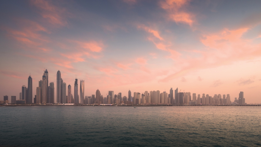 Timelapse of skyscrapers in Dubai Marina, sunset time, UAE | Shutterstock HD Video #1029921356