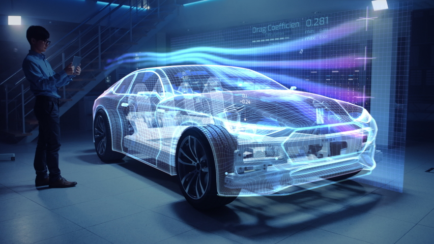 Automotive Engineer Working on Electric Car Chassis Platform, Using Tablet Computer with Augmented Reality 3D Software. Innovative Facility: Vehicle Virtual Mesh Model is Tested for Aerodynamics.   Shutterstock HD Video #1029926639