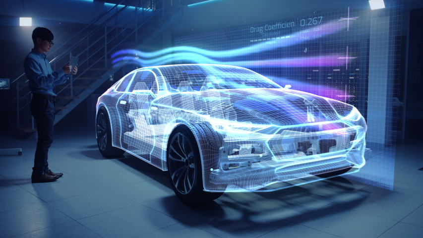Automotive Engineer Working on Electric Car Chassis Platform, Using Tablet Computer with Augmented Reality 3D Software. Vehicle Virtual Mesh Model is Tested in Digital Wind Tunnel. Royalty-Free Stock Footage #1029926645
