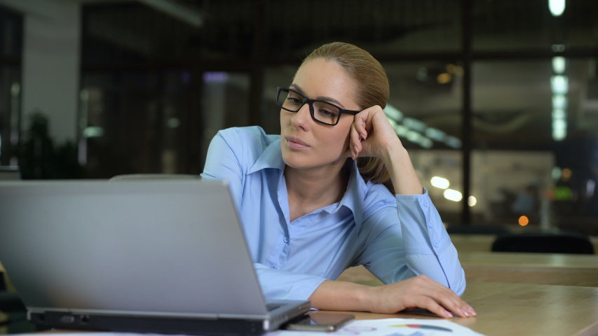 Woman gets more paperwork at end of working day, closing folder to avoid job | Shutterstock HD Video #1029939413