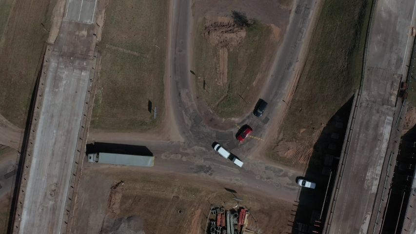 Aerial footage of road construction in Latvia. Suitabe to show road construction work at spring or autumn. | Shutterstock HD Video #1029958535