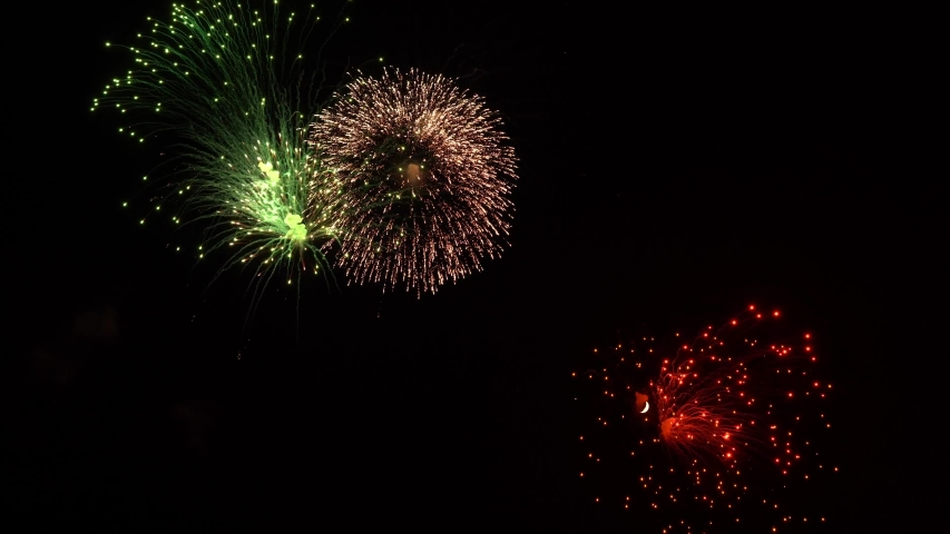 Dazzling fireworks illuminate the night sky. On the moonlit sky bright fireworks. | Shutterstock HD Video #1029963362