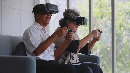 Slow motion scene video of senior Asian couple using VR device which are fun virtual computer or video games.