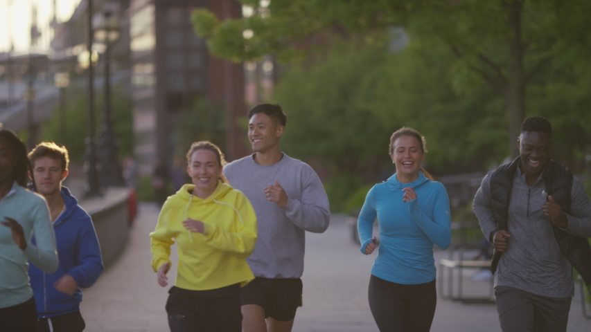 Diverse group of joggers running together, in slow motion | Shutterstock HD Video #1030039271