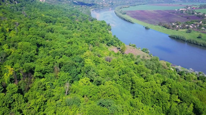 Flight over the river and forest at spring time. Dniester river of Moldova republic. | Shutterstock HD Video #1030040345