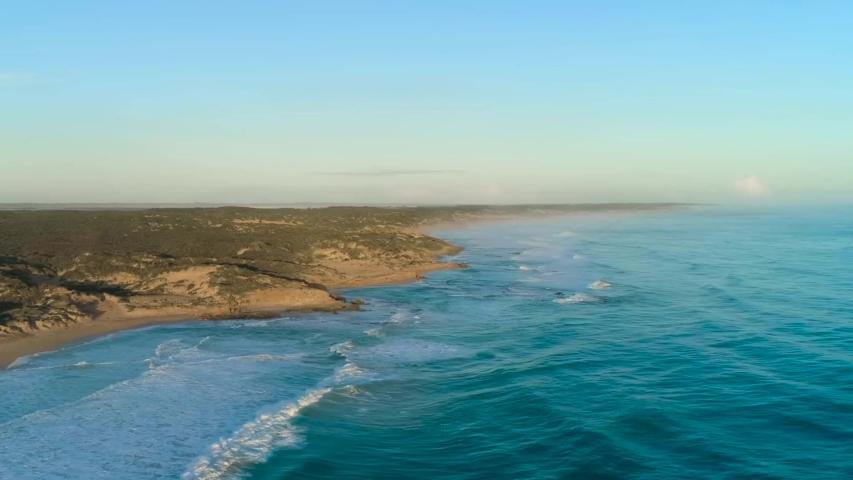 Waves In the open Sea crashing on the shore, Bird's Eye View | Shutterstock HD Video #1030055042
