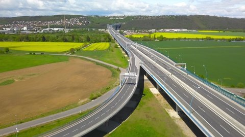 Aerial drone view of traffic on road highway interchange flyover overpass junction on a sunny day near Prague, Czech Republic, Europe.