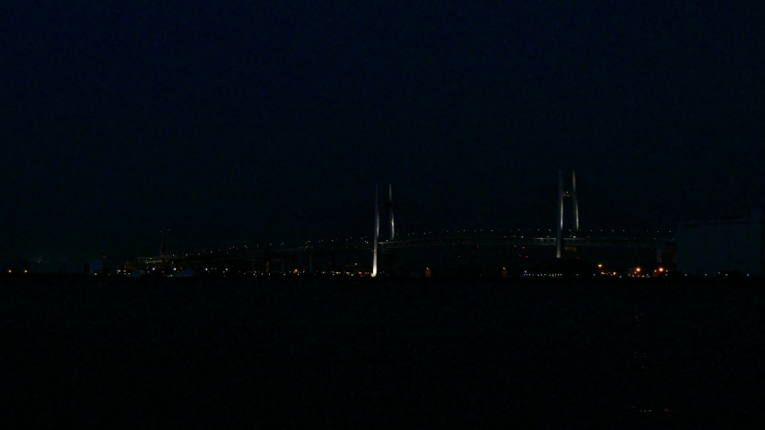 View of Yokohama bay area in Yokohama City, Kanagawa Prefecture, Japan. Yokohama Bay Bridge is a diagonal bridge connecting Honmoku Pier and Daikoku Pier.