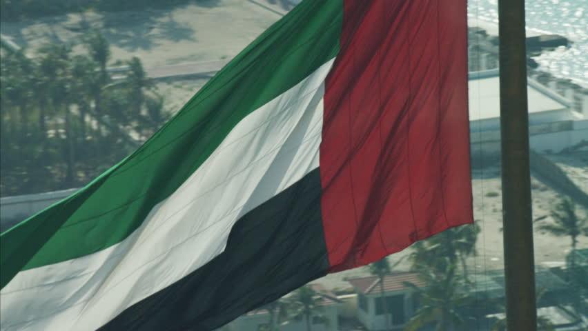 Aerial National Flag flying Pole Urban District Dubai UAE | Shutterstock HD Video #10300850