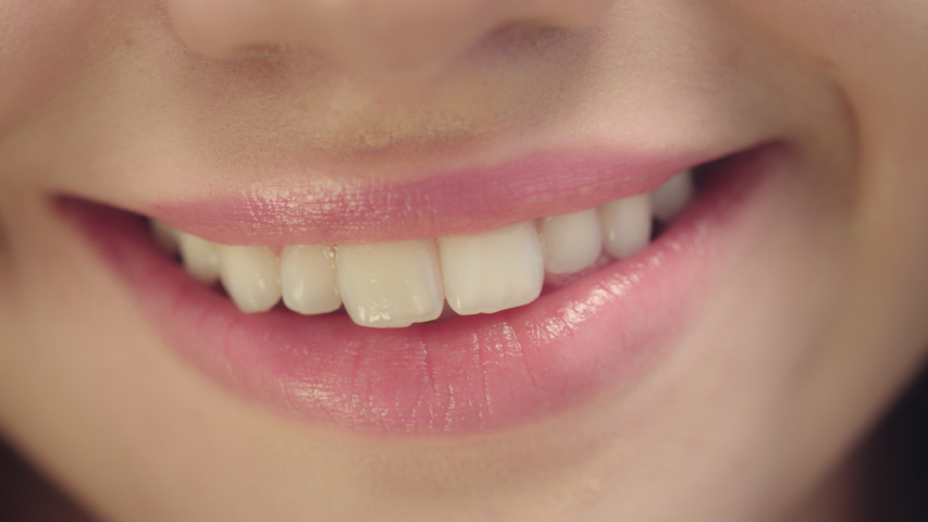 Smiling female mouth with ideal white teeth. Close up of smiling woman face with perfect smile. White teeth smile concept