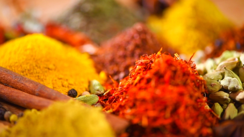Spices and Herbs. Various Indian backdrop of Spice and herb rotate background. Assortment of Seasonings, Dry colorful condiments on wooden table. Cooking ingredients, flavor. 4K UHD Royalty-Free Stock Footage #1030148654