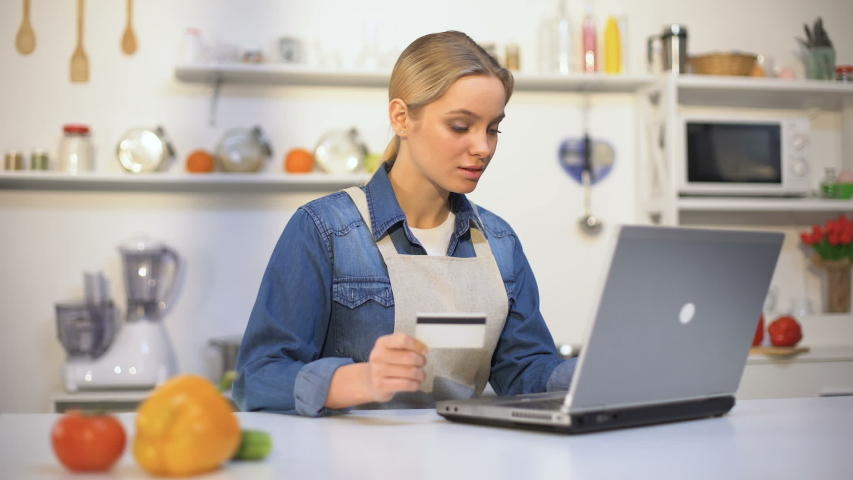 Beautiful girl paying for food purchase over internet, convenient online service | Shutterstock HD Video #1030150472