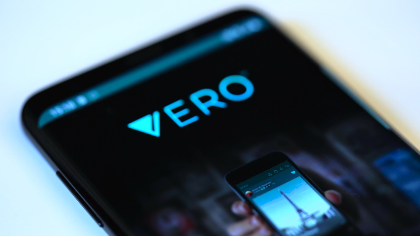 VENICE, ITALY - May 2019 : Finger tapping the Vero icon to open the application on a smartphone. #1030161392