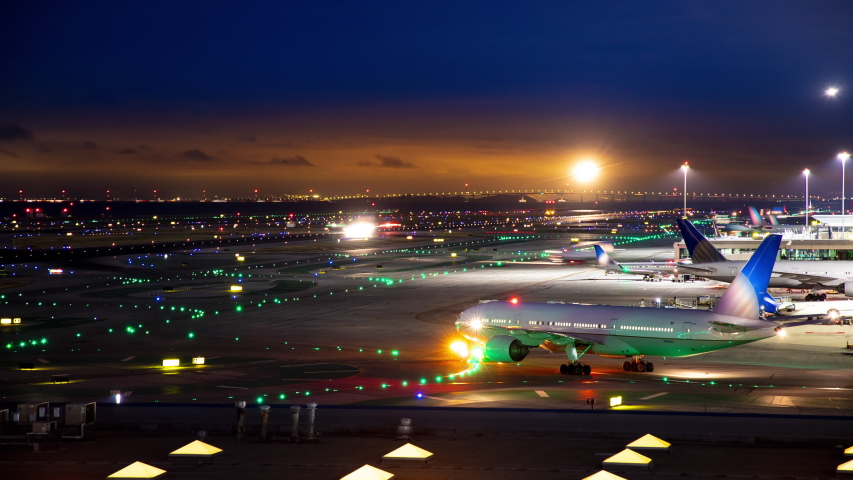 Generic Unmarked International Airport Airfield Night Timelapse with Moving Lights from Commercial Jet Airliners near San Francisco California United States of America | Shutterstock HD Video #1030180550