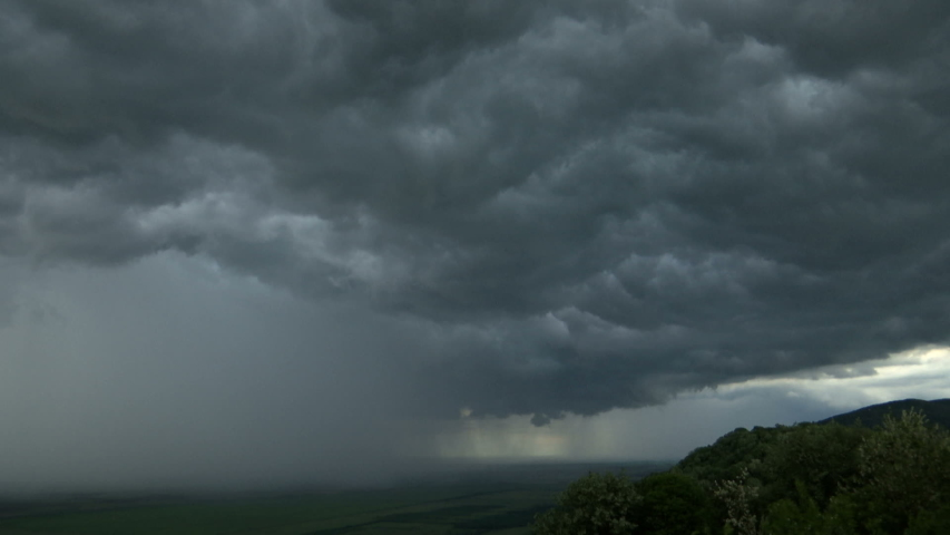 Time lapse storm is coming - dramatic rain clouds approach the hill | Shutterstock HD Video #1030185725
