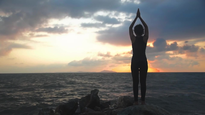 Young Woman Standing Yoga Pose on of Beach.   Shutterstock HD Video #1030204511