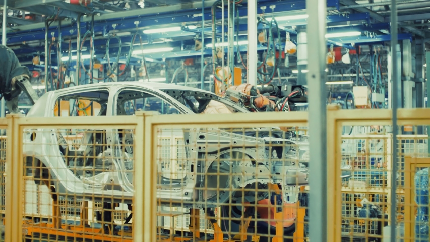 Robotics work in production line of car parts at factory | Shutterstock HD Video #1030211216