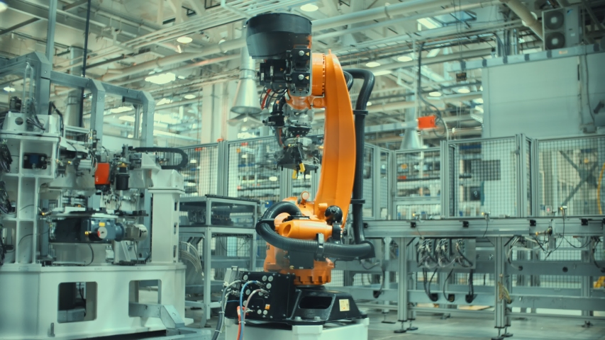 Time Lapse Robotic Arm Assembles Parts for a Car.