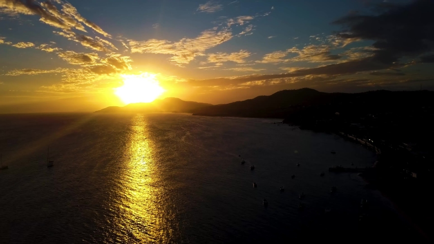 View of the bay of the small town of Esmeralda located in Vieques Puerto Rico during sunset and dusk with beautiful vivid colors among boats, islands, and coast. | Shutterstock HD Video #1030212239